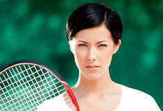 Portrait of successful female tennis player Stock Photography