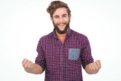 Portrait of successful hipster with clenched fist. Against white background royalty free stock photos