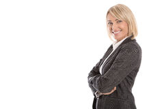 Portrait: Successful isolated older or mature blond businesswoman in blazer and white blouse. Portrait: Successful isolated older or mature blond business woman royalty free stock images