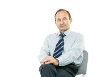 Portrait of a successful lawyer - consultant on white background. Portrait - lawyer consultant sitting in my Desk chair on a white background. the photo has a Royalty Free Stock Images