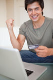 Portrait of a successful man shopping online Royalty Free Stock Photos