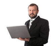 Mature business man with laptop Stock Images