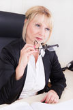 Portrait of a successful older businesswoman with glasses Stock Image