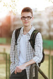 Portrait of successful smiling young student with glasses Royalty Free Stock Images