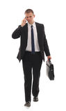 Portrait of a successful young business man carryi royalty free stock photos