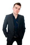 Portrait of a successful young business man. Hands and pockets. Royalty Free Stock Image