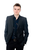 Portrait of a successful young business man. Hands and pockets. Royalty Free Stock Images
