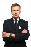 Portrait of a successful young business man standing isolated on grey background Royalty Free Stock Photos