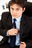 Portrait of successful young businessman at office Royalty Free Stock Image