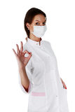 Portrait of successful young female doctor. Isolated on a white background Royalty Free Stock Images