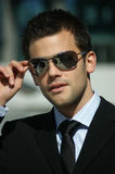 Portrait of a successful young man. With sun glasses stock photos