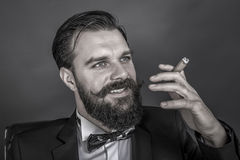 Portrait of a successful young man with retro look smoking a cig Royalty Free Stock Images