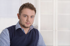 Portrait of successful young manager in his office. Stock Images