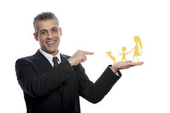 Portrait of a sucessful businessman pointing to his family Royalty Free Stock Photo