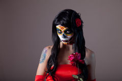 Portrait of sugar skull girl with red rose. Day of the Dead Halloween theme royalty free stock images