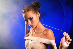 Portrait of sultry beautiful young gymnast woman posing with gymnastics tape stock image