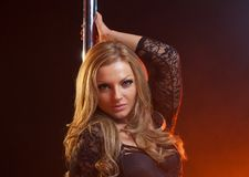 Portrait of a sultry female pole dancer Royalty Free Stock Photography