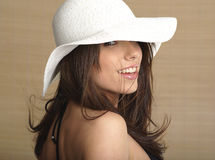 Portrait of summer woman. Glamour portrait of summer lady, bamboo background. model wearing a white sun cap Stock Photos