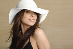 Portrait of summer woman. Glamour portrait of summer lady, bamboo background. modr wearing a white sun cap Stock Images