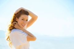 Portrait of summer young woman outdoors. Soft sunny colors. Stock Photo