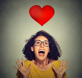 Portrait super excited funky girl in love looking up at red heart Stock Photo
