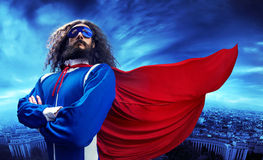 Portrait of a superheroe posing over the urban landscape Royalty Free Stock Images