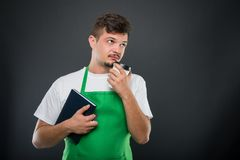 Portrait of supermarket employer holding agenda and coffee Royalty Free Stock Image