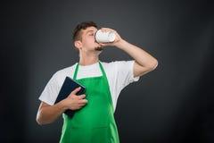Portrait of supermarket employer holding agenda drinking coffee Stock Image
