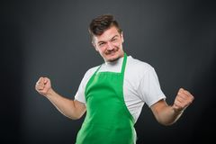 Portrait supermarket employer holding fists looking happy. Like winning concept on black background Stock Photo
