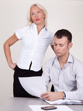 Portrait of supervisor and flirty secretary Stock Images