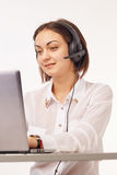 Portrait of a support phone operator. In headset Stock Photos