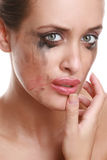 Portrait of the suppressed girl. With the smeared cosmetics Stock Images