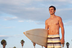 Portrait of a surfer on the beach Royalty Free Stock Photography