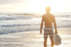 Portrait of a surfer on the beach Stock Photography