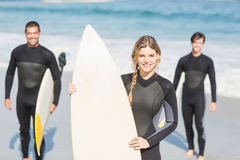 Portrait of surfer friends with surfboard standing on the beach Stock Image