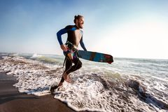 Surfer man with surf board on the beach. Summer sport activity. Portrait of surfer man with surf board on the beach. Summer sport activity royalty free stock photos