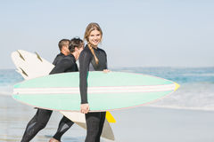 Portrait of surfer woman with surfboard standing on the beach Royalty Free Stock Photography