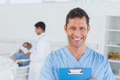 Portrait of surgeon with doctor attending patient on background Royalty Free Stock Photos