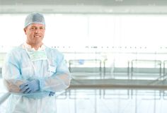Portrait of surgeon doctor on hospital corridor Stock Photography