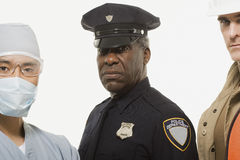 Portrait of a surgeon a police officer  a construction worker Royalty Free Stock Photos