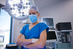 Portrait of surgeon standing with arms crossed in operation room Royalty Free Stock Photography