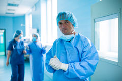 Portrait of surgeon standing in operation room Royalty Free Stock Photos