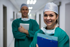 Portrait of surgeons standing in corridor Stock Photo