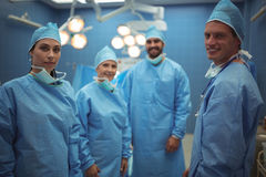 Portrait of surgeons standing in operation theater Stock Photo