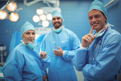 Portrait of surgeons standing in operation theater Stock Photos