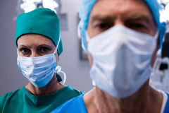 Portrait of surgeons wearing surgical mask in operation theater. Of hospital Royalty Free Stock Photo