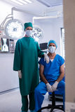 Portrait of surgeons wearing surgical mask in operation theater. Of hospital Royalty Free Stock Photography