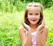 Portrait of surprised adorable little girl in summer day Royalty Free Stock Photo