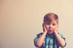 Portrait of surprised and amazed caucasian boy. Looking at the camera. Shocked child posing on white background with copyspace Stock Photos