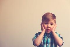 Portrait of surprised and amazed caucasian boy Stock Photos